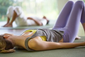 Woman laying on yoga mats